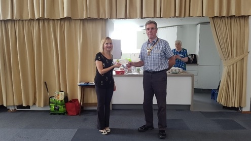 Jim presenting Dementia Club UK with a donation