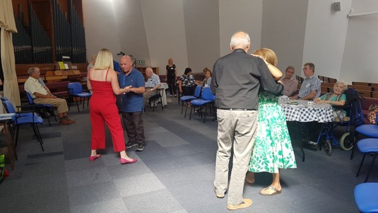 Singing and dancing session at the Dementia Club