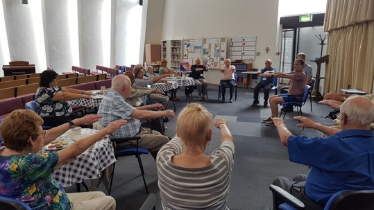 Dementia Club Members doing a chair yoga session